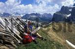 Thumbnail hiker with child having a break under the Kangkofel south of the Comici lodge with view to the Dolomites South Tyrol Italy
