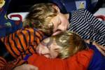 Thumbnail exhausted children 8 and 10 years old sleeping in the car in the security seats