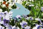 Thumbnail Easter decoration with a blue Easter Bunny on a flower meadow