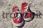 Thumbnail Worn, red kids shoes in sandbox