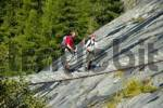 Thumbnail Couple hikers traverses a suspension bridge below Glacier de Bionnassay Haute-Savoie France