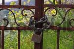 Thumbnail this gate, ensured with a strong lock and chain, leads to a wild garden at Lipari island, Italy.