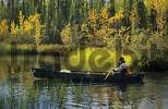 Thumbnail man sitting in a canoe, Northwest Territories, Canada