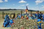 Thumbnail Pile of stones with prayer flags Ovoo in wide open steppe Mongolia