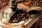 Thumbnail Old-fashioned coffee grinder atop a bed of coffee beans