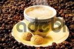 Thumbnail Espresso in a yellow cup atop a bed of coffee beans