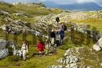 Thumbnail MR Hiking group on the path through the high fjell Vestvagoya Lofoten Norway