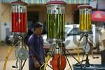 Thumbnail Caltex fuel station with colourful fuel in the fillings Stung Treng Cambodia