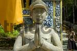 Thumbnail Figure of a praying uniformed man at the entry to Phnom Santuk near Kompong Thom Cambodia
