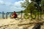 Thumbnail man squats on a lonesome beach in thoughts near Sihanoukville Kompong Som Cambodia