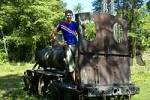 Thumbnail young man stands on old steam engine Ban Khon Don Khon Si Phan Don Laos
