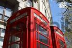 Thumbnail two red traditional phone boxes with the label Telephone in the City of London, Great Britain