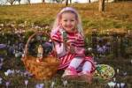 Thumbnail girl with Easter basket in spring meadow