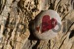 Thumbnail Red heart painted onto a stone