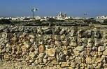 Thumbnail typical stone wall with city of Dingli, Malta