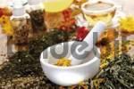 Thumbnail Homeopathic medicinal plants - mortar and pestle with pot marigold petals