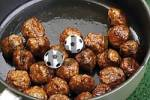 Thumbnail Football fast food - meatballs in a pan with two miniature footballs