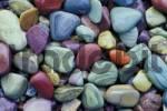 Thumbnail colorful pebbles at the shore of McDonald Lake Glacier National Park Montana USA