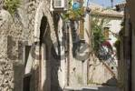 Thumbnail Narrow alley between old stone buildings in Gerace, Calabria, Southern Italy