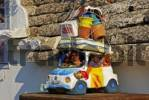 Thumbnail Sculpture of a family going on vacation with a fully loaded car, Alberobello, Valle dItrea, Bari Province, Apulia, Southern Italy