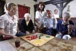 Thumbnail Nurses and residents of an old-age home or nursing home playing board games in the afternoon