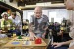 Thumbnail Residents and nurses playing board games at a nursing home
