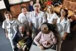 Thumbnail Residents and caretakers, nursing staff in the common room of a nursing home