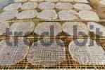 Thumbnail Thin rice paper drying in the sun, Mekong Delta, Vietnam, Southeast Asia