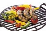 Thumbnail Fried bratwurst sausages on a grill with fresh peppers and tomatoes