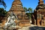 Thumbnail Sitting Buddha figure in ruined Aung Zaw Paya Ava Inwa Mandalay Burma