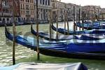 Thumbnail blue covered gondolas at Canale Grande in Venice Italy