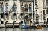 Thumbnail facade of a house with Italian and venice flag at Canale Grande in Venice Italy