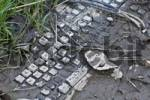Thumbnail Computer keyboard covered in mud
