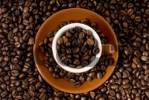 Thumbnail Espresso cup filled with coffee beans