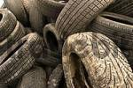 Thumbnail old motor-car tires on a garbage depot