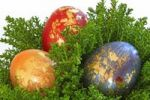 Thumbnail Coloured easter eggs with golden ornament in an easter basket