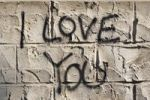 Thumbnail The words I love you as graffiti on the outside walls of a house