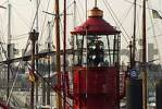 Thumbnail Beacon of ancient lightship Elbe 1 among the masts of ancient sail ships at Haburg Harbour, Hamburg, Germany