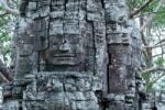 Thumbnail Stone sculpture, face of Bodhisattva Lokeshvara on a monumental tower in the Ta Som Buddhist Temple, Siem Reap, Cambodia, Southeast Asia