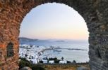 Thumbnail View through an old stone archway towards the old port of Mykonos, Cyclades, Greece, Europe