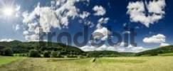 Thumbnail Panoramic view of a hay meadow and cloudy sky, Altmuehltal Valley near Obereichstaett, Bavaria, Germany, Europe