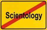 Thumbnail Sign, end of city limits, as symbol for the end of Scientology