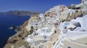 Thumbnail View over the town of Oia, Ia, with typical interlocked Cycladic architecture, in front of the blue sea, Santorini, Cyclades, Greece, Europe