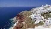 Thumbnail View over the town of Oia, Ia, on a craters edge with a typical Cycladic architectural style, Santorini, Cyclades, Greece, Europe