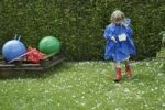Thumbnail Blonde girl, 6 years old, collecting hailstones after a storm, 11.8.2008, Nicklheim, Bavaria, Germany, Europe