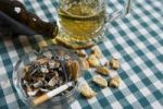 Thumbnail Beer, beer glass, cigarette, ashtray, full, cigarette stubs, savoury biscuits, empty beer bottle