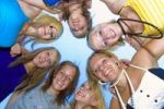 Thumbnail Symbolic picture for circle of friends, teenage girls standing head to head in a circle