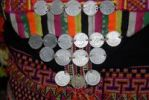 Thumbnail Historic Laotian Kip coins sewn as decoration onto the traditional costume of a woman of the Akha Pala ethnic group, Ban Saenkham Tai, Phongsali Province, Laos, Southeast Asia
