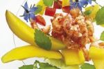 Thumbnail Crab meat salad with Mango, Borage flowers, diced red Capsicum and Lemon Balm
