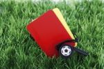 Thumbnail Red and yellow cards with a referees pipe on artificial turf